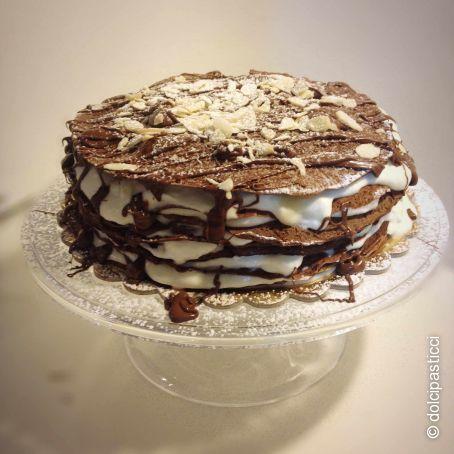 https://www.tribugolosa.com/media/torta-crepes-gf-1_crop.jpg/rh/torta-di-crepes-al-cacao-con-crema-diplomatica-senza-glutine.jpg